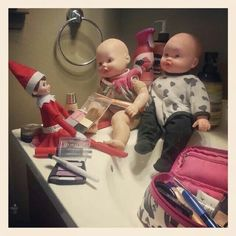 Elf on the Shelf. Twinkle got into Mommy's makeup and gave some of Mira's babies makeovers!