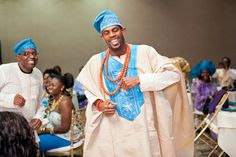 Nigerian Brocade with Nigerian-style contrast embroidery for men: brocade is a cotton fabric with a design imprinted on it. The fabric is either left white, dyed a solid color or tie dyed.