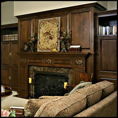 Gas fireplace with carved wood mantel, marble surround and cast iron grate