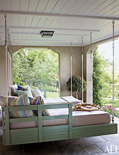 10 of 15 © Photo: Francesco Lagnese Hanging loungers are suspended on the sleeping porch of a charming Northern California home, allowing plenty of room for rest and play.