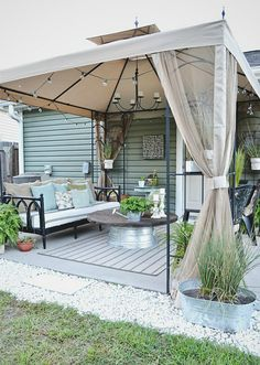 Thrift store finds and repurposed items create the perfect outdoor space. #decorideas #homemakeover