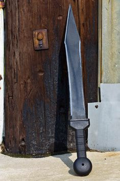 Cold Steel Gladius Sword... An absolute turn on!! She has the prefect weight, edge, point, and versatility behind her.