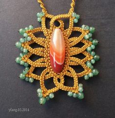 Gold flower fruity macrame pendant with green aventurine and carnelian..