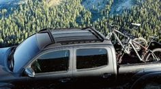 The Genuine Toyota Tacoma Roof Rack PT278-35130 integrates with roof rail channels and features stowable cross bars. The cross bars unfold to a locked position for use and can be stowed in line with the roof rails when not in use. Offering a 75-lb. load capacity, the roof rack is available for Double Cab only and comes with mounting hardware.