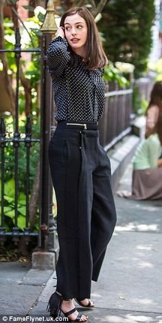 Playing a working mum: Anne looked ultra sophisticated in her chic dotted button-up, wide-leg trousers, and fringed heels