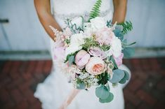 peony bouquet - photo by Michelle Gardella Photography http://ruffledblog.com/romantic-seaside-wedding