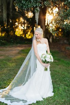 bride in a romantic Justin Alexander gown / photo: sophantheam.com