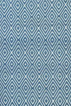 Dash & Albert   Diamond Denim/White Indoor/Outdoor Rug   A rug for all seasons.  Made of superheroic polypropylene, our indoor/outdoor area rugs are terrific for high-traffic areas and muddy messes. Scrubbable, bleachable and UV-treated for outdoor use, this collection of woven rugs can stand up to all that you dish out.