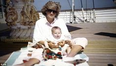 This picture,taken by Prince William, shows the princess sitting and playing with Prince ...