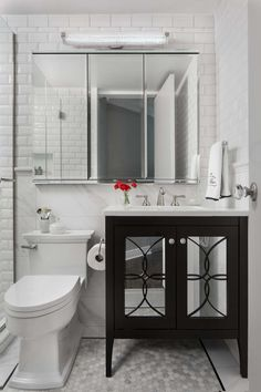 A Clic Black And White Bathroom With Mirrored Front Vanity Robern Medicine