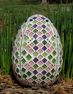 "Mosaic Easter Egg by siriusmosaics, via Flickr this is a 8"" Ceramic egg with Colorfusion tiles, glass beads. Used white grout and then painted it with pearl and glitter paint to give it that look old time eggs had that were covered with glitter."