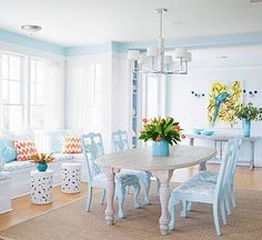 Painted chairs and tables.  Like the bay window built-in window seat and use of garden stools.