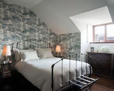 Example of a minimalist dark wood floor bedroom design in New York with multicolored walls