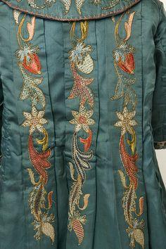 1890 Embroidered coat back detail