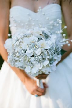 this bouquet rocks. brooches at the center of silk flowers.