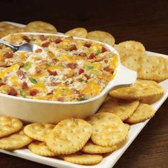 Creamy Bacon and Cheese Dip    16 ounces sour cream  8 ounces cream cheese, softened  2 cups (8 oz.) shredded Cheddar cheese  1 jar (3 ounces) bacon bits  1 cup chopped green onions  1 envelope onion soup mix  crackers    1. Preheat oven to 400°F. In a mixing bowl, stir together sour cream and cream cheese. Fold in shredded cheese, bacon bits, green onions and onion soup mix.    2. Pour into a 2-quart baking dish. Cover and bake in oven for 25 to 30 minutes or until hot and bubbly.