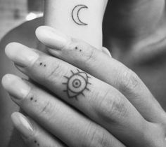 eyela.tumblr.com small minimal finger tattoos, sun, crest moon, eye