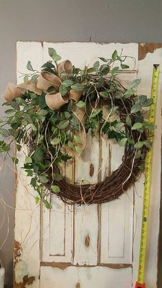Handmade item Materials: grapevine wreath, glue, wire, wired burlap, realistic fern, realistic greenery Made to order Ships from United States Questions? Contact shop owner Item details This beautiful burlap greenery wreath is the perfect simple accent for your door or interior. A wired burlap ribbon makes a simple bow. Average Diameter: 22 (tip to tip) This wreath will be created on a grapevine wreath measuring approximately 18 Indoor/ Sheltered Outdoor Safe **avoid exposing this wreath ...