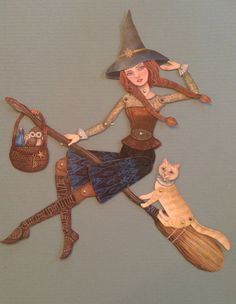 @This little witch is ready for adventure, with her two sidekicks, Frick the fancy cat and Morty the lazy owl. They enjoy delivering their home brewed potions and elixirs; for invisibility, to breathe underwater and spells to keep squirrels out of your bog garden. Paper dolls are one of the most relaxing and simple of crafts. Theyre perfect for rainy days, or evenings when you want a quiet activity to enjoy over a cup of tea and good conversation. Lately, Ive enjoyed assembling my dolls…