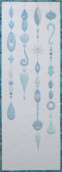 Sampaguita Quilts: 2012 at Sampaguita Quilts. Silver and aqua on white cloth.