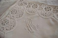 Fabulous monogram on pillowcases edged with Irish Crochet Lace, just beautiful. McBurney & Black