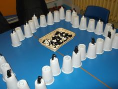 £1 shop cups again ... white ones as icebergs with numbers 0-30 on this time ... these 3 children made a great game up ... they put the numbers in order and then took it in turns to put on the even numbered penguins! Very Clever! LH