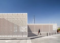Perforated cladding unifies SCOB's Barcelona marina buildings