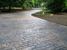 Stamped Concrete Random Cobblestone Driveway   by Ralph612