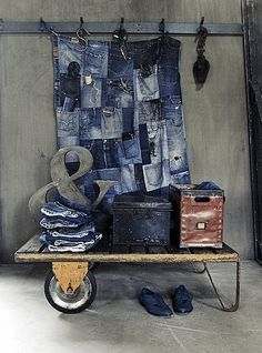 Sew together old denim pockets for convenient wall storage.