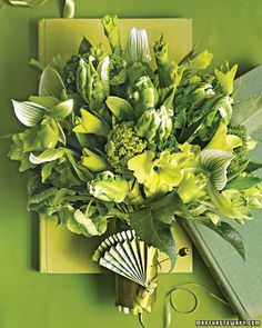 "Say ""I do"" to an all-green bouquet with lady's slippers orchids, parrot tulips, and gladiolus"