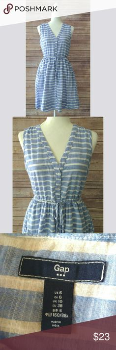 Gap chambray striped sleeveless shirtdress Gap chambray dress in a light blue and white stripes.  It has buttons down the front and a drawstring at the waist.  It is about above the knee length.  It has a v-neck.  It is a very lightweight dress with white lining.  This is a great summer dress!!!                                         Pet free smoke free home. GAP Dresses