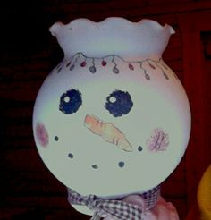 Use your old bud vases for a cute snowman that you can fill with candy or burn a candle.