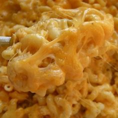 Slow Cooker Macaroni, Cheese and Corn.   2 can creamed corn-undrained  2 cans corn-undrained  4 tbs melted butter  2 cup uncooked elbow noodles  2-3 cups shredded cheddar or Velveeta  Mix all together, spray the crock with non-stick spray. Cook on low until noodles are cooked. 2-4 hrs.