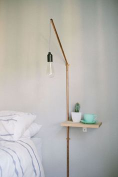 Suspended bedside light with pipe