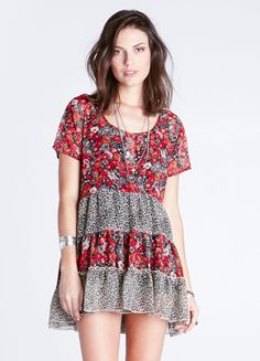 Tiered chiffon babydoll dress featuring floral print with leopard print inset and decorative buttons at the bust. Slip included.