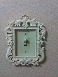 Light switch cover is really a picture frame.  Use Command strips to avoid extra holes and be able to switch out styles.