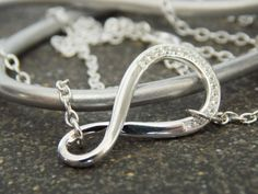 Infinity Necklace // Silver CZ Stones by KreationsbyKarenNB