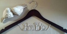Check out this item in my Etsy shop https://www.etsy.com/listing/461999408/bride-hanger-bridal-hanger-one-line