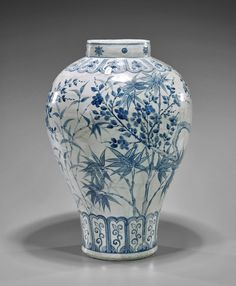 Tall Choson-Style Blue & White porcelain vase; of baluster form with short neck, a continuous design of lush bamboo and plum blossoms; elaborate borders to neck and base; celestial band at neck, H: 16 1/4""