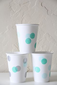 Decorate cups for a bingo party with daubers.-stack them on table