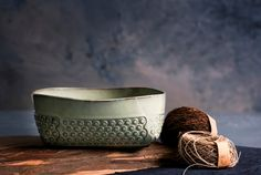 Mint green stoneware salad bowl, made of light green matte glazed ceramic with a light Relief polka dots pattern. Bowl is folded from a ceramic surface by hand creating square corners. Great to serve your fresh picked fruits or a green salad. could be easily used for cooking or baking a