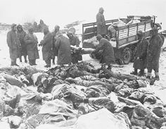 Frozen bodies of American Marines, British Commandos and South Korean soldiers are gathered for a group burial at Koto-ri.  December 1950.
