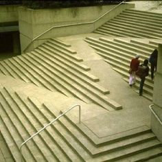 Stairs and wheelchair ramp incorporated into one space. Architecture and art all in one.