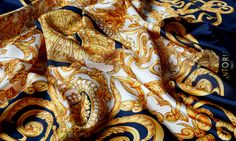 ANTORINI: This beautiful limited edition ladies scarf is manufactured by hand using the softest lightweight silk from Como in Italy. The magnificent design depicts golden ornaments bordered in blue and finished by hand with finely rolled hand-stitched edges. Perfect for all occasions. www.antorini.com  #scarves #fashionaccessories #luxuryfashion #antorini