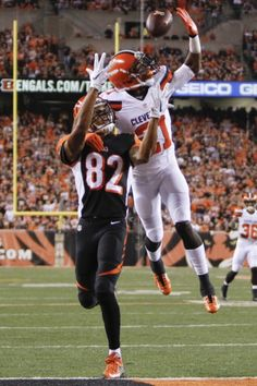 Cleveland Browns cornerback Justin Gilbert (21) breaks up a pass to Cincinnati Bengals wide receiver Marvin Jones (82) during the first half of an NFL football game, Thursday, Nov. 5, 2015, in Cincinnati. (AP Photo/Frank Victores)