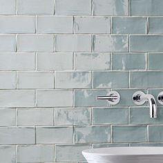 The SomerTile Thames Acqua 3 in. x 6 in. Ceramic Wall Tile has a unique handmade look.  Glossy blue glaze, watercolor finish, natural variations in the surface. Versatile look and soft color for a soothing atmosphere in any space.