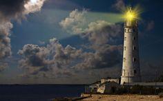 lighthouse ocean sea light sky clouds wallpaper background