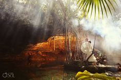 Riviera Maya photography trash the dress in a stunning cenote, love the copal smoke in the sunlight!  Mexico wedding photographers Del Sol Photography
