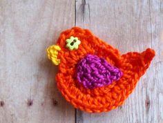 Crochet Bird Applique--Orange & Fuchsia /Tiny Button Eye. $3,50, via Etsy.