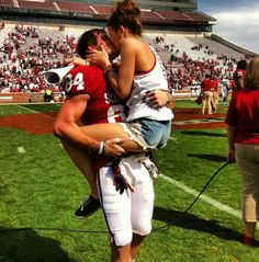 Love this image. Wearing football gear, holding his girl, her legs wrapped around him, kissing.
